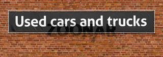 Used cars and trucks written on a banner