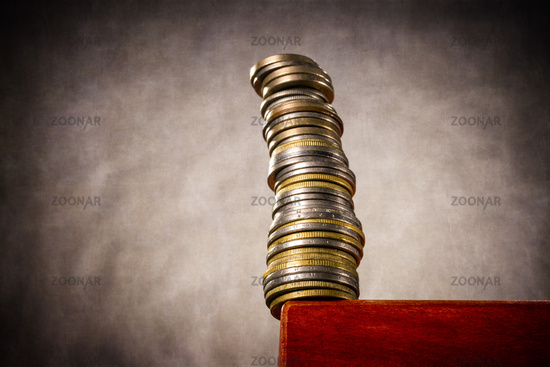 Stacked coins on a table edge