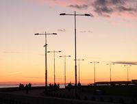 Silhouettes of lanterns at sunset.
