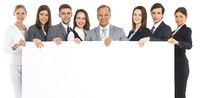 Business team holding blank billboard