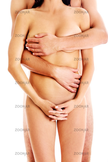 Man covering woman's nude body