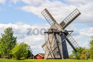 Windmill at a farm in a rural landscape