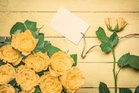 Message card tied to a yellow rose