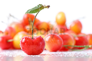 Sweet cherries with droplets isolated on white
