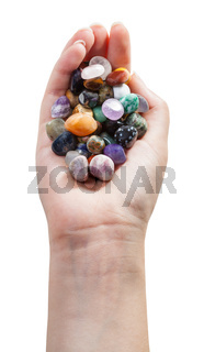 above view of palm with various gemstones