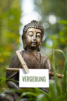 Buddha statue with the word Vergebung