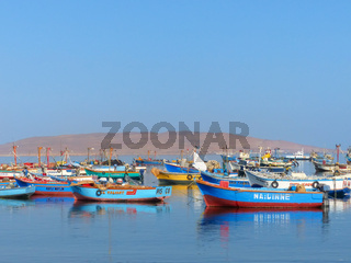 Colorful fishing boats anchored in Paracas Bay, Peru