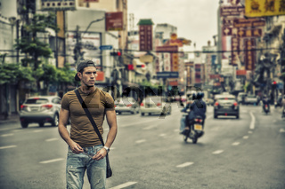 Handsome young man walking in Bangkok, Thailand