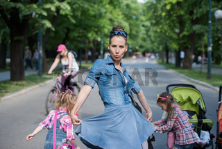 mother with her daughters in the park