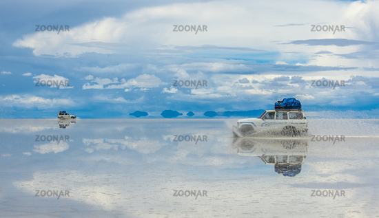 Off-road vehicles driving in Salar de Uyuni, Bolivia, the world's largest salt flat