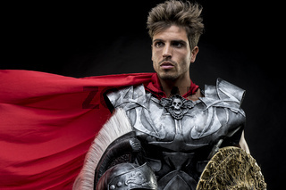 Invasion, centurion or Roman warrior with iron armor, military helmet with horsehair and sword