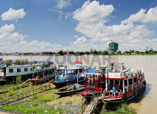 tourist river tour boats in riverside phnom penh city cambodia