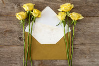 Roses and letter with golden envelope