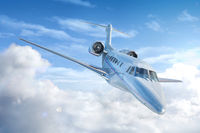 Private Jet airplane flying.