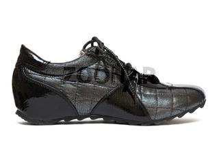 Black running womanish shoe isolated on white background
