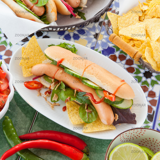 Fresh hot dogs with tortilla chips
