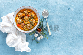 Meatballs in sauce with vegetables, top view