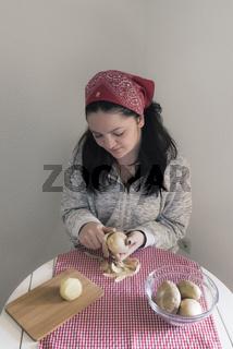 Woman peeling potatoes
