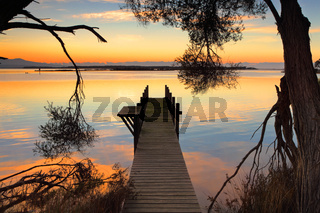 Rustic jetty sunrise