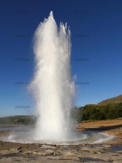 eruption of geyser Strokkur in Iceland