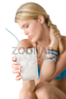 Beach - Happy woman in bikini with cold drink