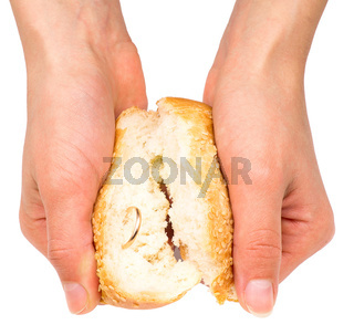 Hands holding bun with wedding ring inside