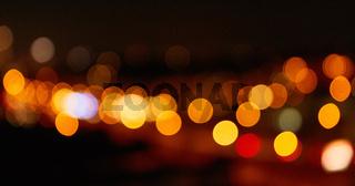 Abstrakter Hintergrund mit Lichtern bei Nacht