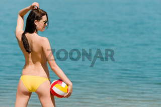 Summer beach woman enjoy sun hold ball