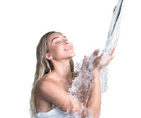 Young pretty blonde catching water stream in hands