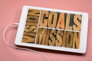 vision, goals, mission concept on tablet