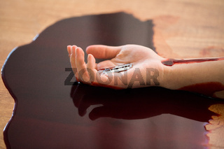 dead woman hand in blood on floor at crime scene
