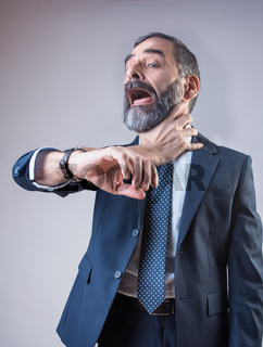 Wristwatch choking a senior business man