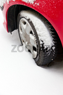 Winter tires of a car in the snow.