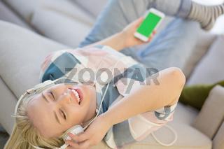 girl enjoying music through headphones