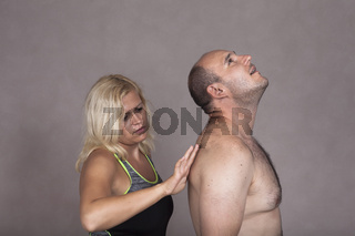 Woman giving massage to naked man