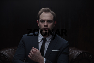 Portrait of a businessman on black background