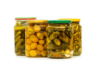 Pickled cucumbers and olives in glass jar