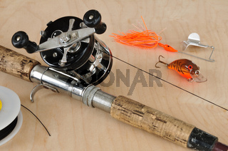 Rod and Baitcasting Reel and Other Fishing Gear on a Board