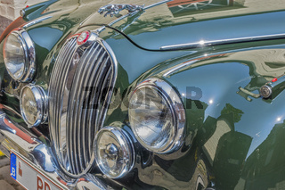 Front View Of Green Jaguar Mk 2 Car Showing Radiator Grill and Lights