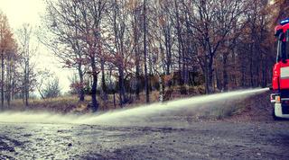 Hose eliminating mud after flooding.