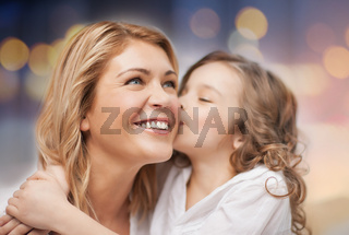 happy mother with daughter hugging and kissing