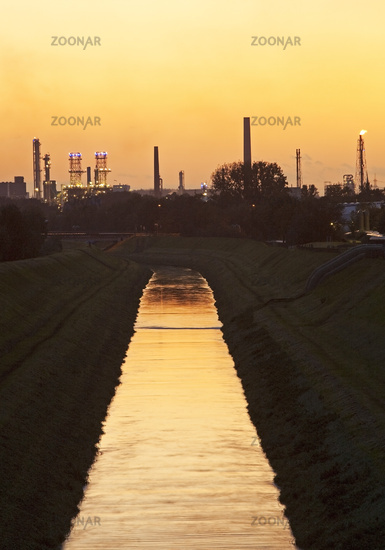 river Emscher with BP oil refinery at sunset, Gelsenkirchen, Ruhr Area, Germany, Europe