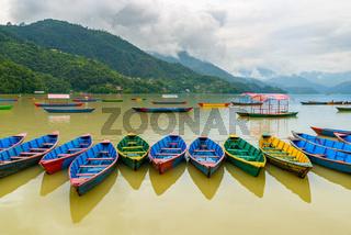 Small boats on Phewa Lake in Pokhara