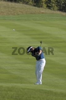 Trevor Immelmann, hits a fairway shot.