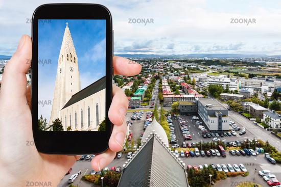 tourist photographs church in Reykjavik city
