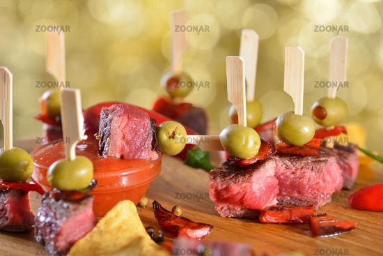 Hot steak tapas with chili sauce