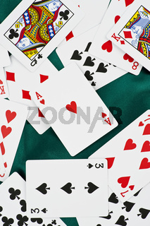 poker cards on green silk