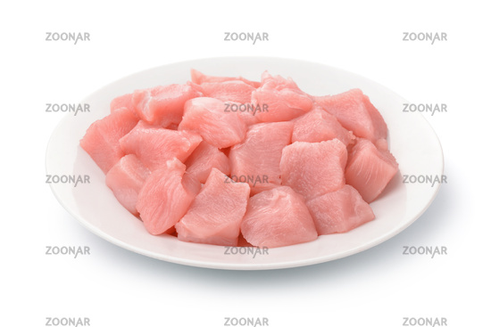 Plate with raw chicken fillet chunks