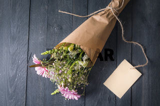Bouquet of mixed flowers and a message card