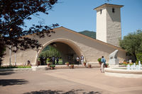 Robert Mondavi Winery Building in Napa Valley with Tourists and Fountain in front.